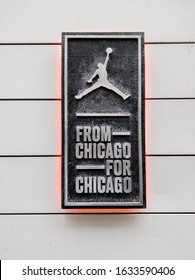 """Jumpman"" logo and sign that reads ""FROM CHICAGO FOR CHICAGO"" outside the Jordan Nike store in downtown Chicago at 32 S State St on Novemeber 17th, 2019."