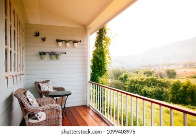 JUN 13, 2013 Thailand : English country vintage balcony interior with natural light and rattan wicker chairs and coffee table