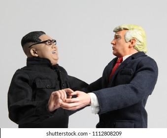 JUN 13 2018: Caricature of US President Donald Trump and North Korean Supreme Leader Kim Jong Un laughing and dancing