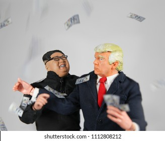 JUN 13 2018: Caricature of US President Donald Trump and North Korean Supreme Leader Kim Jon Un laughing with falling US 100 dollar bills