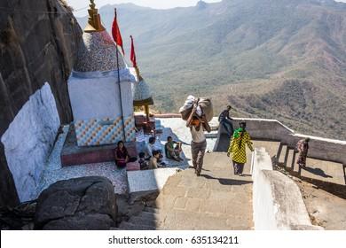 JUNAGADH, INDIA - MARCH 01, 2017: Jain Pilgrims are climbing down the 6000 steps from the temple complex at Mt Girnar, at Junagadh, Gujarat, India