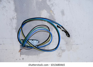 Junction box of electrical wiring on concrete wall
