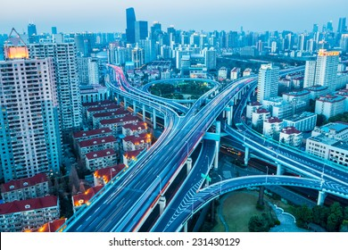 junction of city road at dusk in prosperous city of shanghai , China