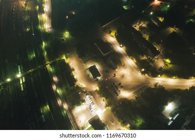 Junction Railway Station with lots of Lines and Freight Trains at Night. Aerial View. Location Kandalaksha Russia