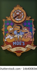 Jundiai, Sao paulo, Brazil - July 25, 2019: Simpsons frame, Moe's bar, Duff beer and a clock. Carpe sum Duff