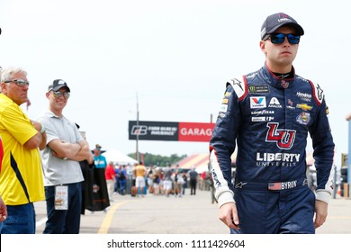 June 08, 2018 - Brooklyn, Michigan, USA: William Byron (24) walks in the garage before opening practice for the FireKeepers Casino 400 at Michigan International Speedway in Brooklyn, Michigan.