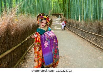 June 1, 2016. Japanese Geisha at Chikurin no Michi (Bamboo Grove) in Arashiyama in Kyoto.