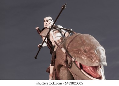 JUNE 1 2018: Recreation of a scene from Star Wars showing Sandtroopers and Dewback in the deserts of Tatooine, searching for the droids with the stolen Deathstar plans - Hasbro action figures