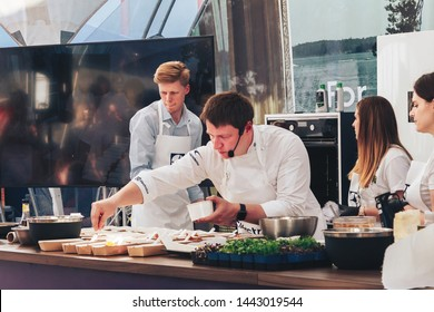 June 1, 2019 Public demonstration of cooking on the street The chef prepares food at the master class Assistants stand nearby