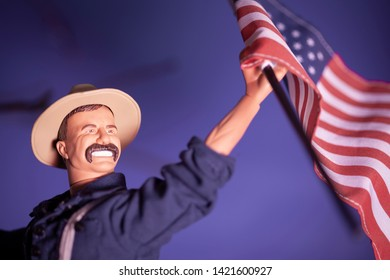 JUNE 1 2019: Theodore Teddy Roosevelt waving American flag, San Juan Hill battle recreation, US - Cuba - Spain war  - Hasbro GI Joe series action figure