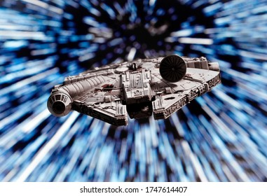 JUNE 1 2020:  Star Wars Millennium Falcon flying through hyperspace - X-Wing miniature game piece