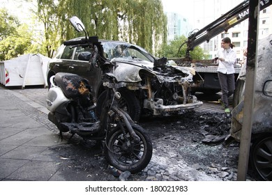 JUNE 10, 2011 - BERLIN: a burned out Porsche Cayenne luxury car - vandalism acts like this have become a common sight in Berlin these days.