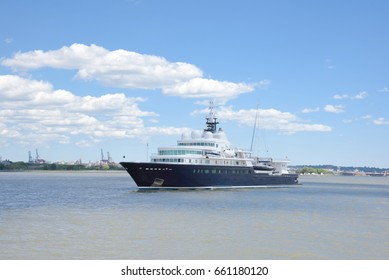 June 10, 2017, New York Harbor, New York City.  Le Grand Bleu yacht is anchored near Ellis Island in New York Harbor.  It is one of the longest yachts in the world at 371 feet.