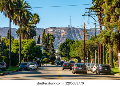 June 10, 2018. Hollywood, USA. Beautiful view of the Hollywood sign from the distance with a street leading to the sign.