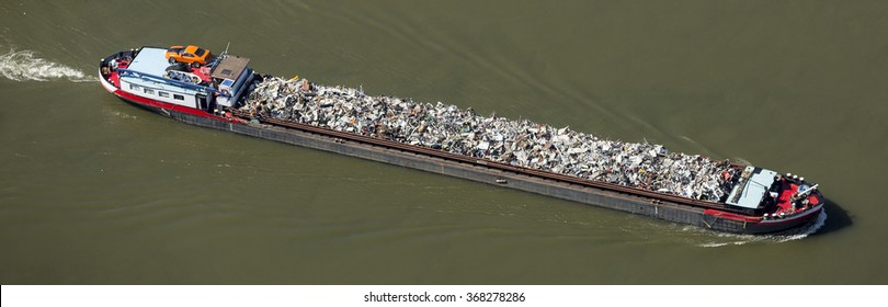 June 11, 2015 Kampen, Netherlands. Aerial view of barge with trash at the river IJssel