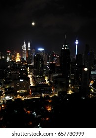 June 11, 2017 - KUALA LUMPUR, MALAYSIA. Evening view of Kuala Lumpur's iconic buildings which include Petronas Twin Towers and KL Tower.