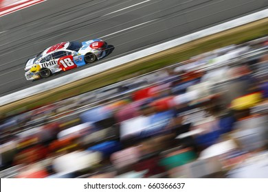 June 11, 2017 - Long Pond, PA, USA: Kyle Busch (18) brings his race car down the front stretch during the Pocono 400 at Pocono Raceway in Long Pond, PA.