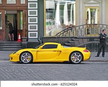 June 12, 2011, Kiev - Ukraine. Yellow Porsche Carrera GT in the center of Kiev. Speedway. Speed. Karbon. Race. Luxurious. Tuning. Supercar. Editorial photo.