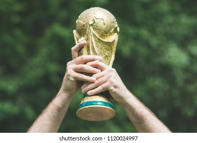 June 12, 2018 Moscow, Russia A man holding a trophy of the FIFA World Cup.