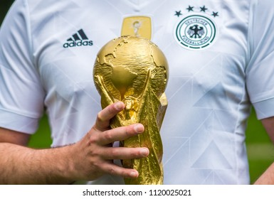 June 12, 2018 Moscow, Russia A man in the T-shirt of the German national football team holds the trophy of the FIFA World Cup.