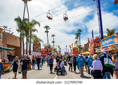 June 12, 2018, SAN DIEGO, CALIFORNIA, USA, Crowds Walk down the Main Street towards the Food Stalls and Rides at the San Diego County Fair
