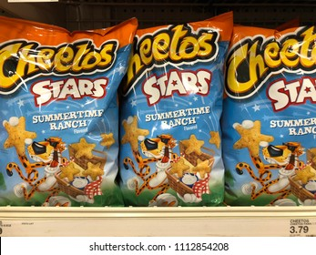 JUNE 13 2018 - Maple Grove, MN: Cheetos Stars cheese potato chip snacks for sale on a shelf inside of a Target grocery store