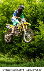 June 13, 2018: Montevideo, United States: Dirtbiker Stands During Jump on homemade track
