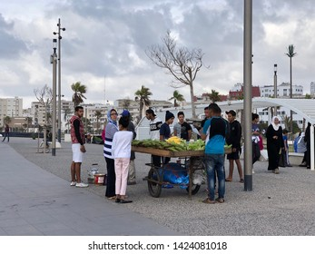 June 13, 2019 Casablanca, Morocco. The Moroccan tourist is purchasing a sweet corn toast at the local market.