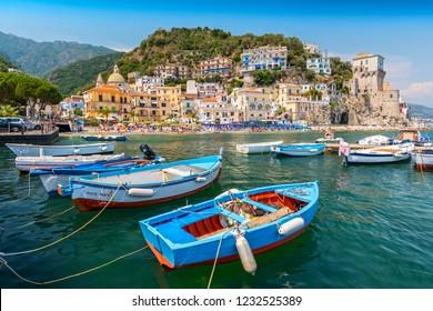June 14, 2017. Leisure boats and traditional buildings in Cetara harbor, Amalfi coast, Italy.