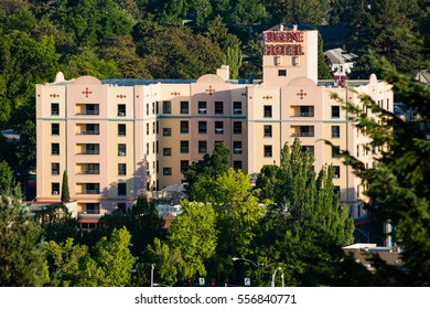 June 16, 2016. Eugene, Oregon, USA. The historic Eugene Hotel rises amidst lush green trees in the southern Willamette Valley.