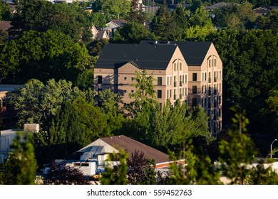 June 16, 2016. Eugene, Oregon, USA. Twin buildings rise in late day sunlight in the lush city of Eugene at the southern end of the Willamette Valley