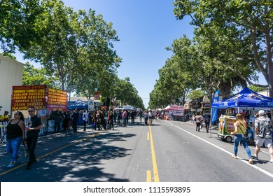 "June 16, 2018 San Jose / CA / USA - People visiting the ""Dancin' On The Avenue"" Live Music Block Party in downtown Willow Glen, South San Francisco Bay Area"