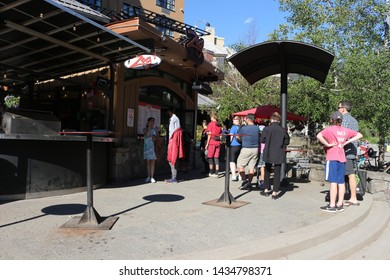 June 16 2018, Whistler Canada: editorial photograph of people in Whistler Village. Whistler village is a tourist village with good food and hotels.