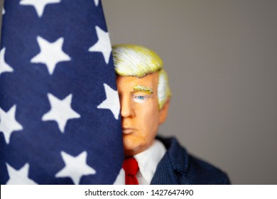 JUNE 16 2019: Caricature of US President Donald Trump hugging an American Flag