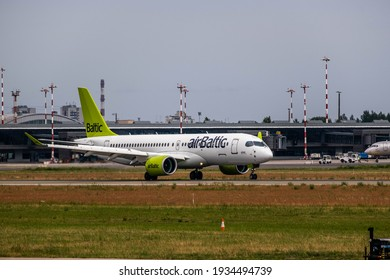 June 16, 2019: Latvian Airbaltic Airbus A220 YL-CSA landing. Editorial capture in Riga, Latvia. RIX airport