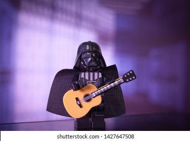 JUNE 16 2019: Lego mini figure of Darth Vader playing a guitar with Death Star Imperial background