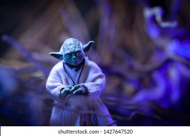 JUNE 16 2019: Recreation of scene from Star Wars The Empire Strikes Back with Jedi Master Yoda on the swamp planet Dagobah - Hasbro action figure