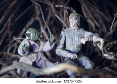 JUNE 16 2019: Recreation of scene from Star Wars The Empire Strikes Back with Jedi Master Yoda and Luke Skywalker on the swamp planet Dagobah - Hasbro action figure
