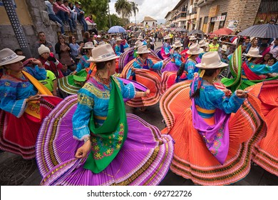 June 17, 2017 Pujili, Ecuador: indigenous women in bright color clothes performing on the street during Corpus Christi parade