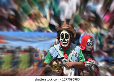 June 17, 2018. Local man with a disguise mask and a colorful costume is participating in the Fiesta de los Locos parade in San Miguel de Allende, Guanajuato Mexico.