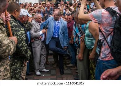 June 19, 2018, In Kiev, Ukraine. People's Deputy Yuri Bereza talks with protesters near the Verkhovna Rada of Ukraine.