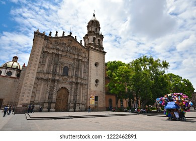 June 19, 2018. San Luis Potosí, Mexico. Panoramic view of the Templo de Nuestra Señora del Carmen with the traditional balloons vendor on the foreground, located in the historic Plaza Del Carmen.