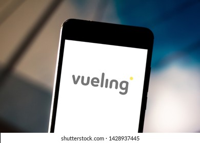 June 19, 2019, Brazil. In this photo illustration the Vueling Airlines logo is displayed on a smartphone.
