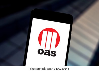 June 19, 2019, Brazil. In this photo illustration the OAS logo is displayed on a smartphone.