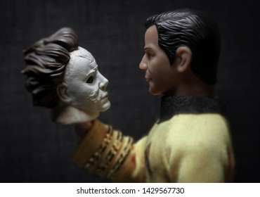 JUNE 19 2019:  Mego style EMCE action figure of Star Trek's Captain Kirk holding a Halloween Michael Myers mask. The mask used in the 1978 Halloween movie was an altered Captain Kirk mask