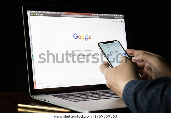 June 19, 2020, Thailand, Bangkok. a man typing on Google search engine from a laptop and phone.