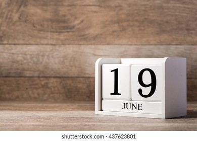 June 19th. Image of june 19 wooden white calendar on wooden background. Summer day. Empty space for text