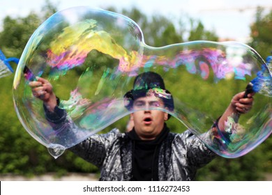 June 2, 2018. Izhevsk, Russia. A man magician in a hat lets large bubbles. Holiday