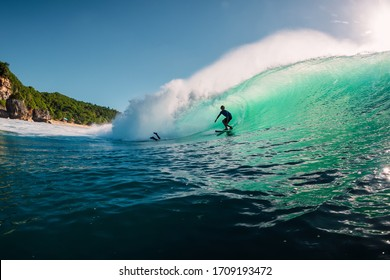 June 2, 2019. Bali, Indonesia. Surfer ride on barrel wave. Professional surfing at Padang Padang