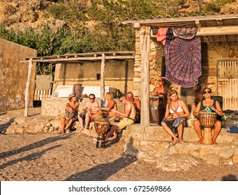 June 20, 2017, Ibiza, Spain. Beach, cove of Benirrás. Hippys musicians playing drums during sunset.